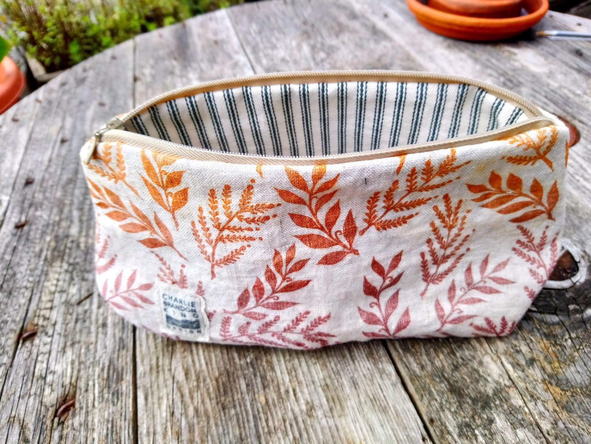 orange leaf make-up bag inside shot