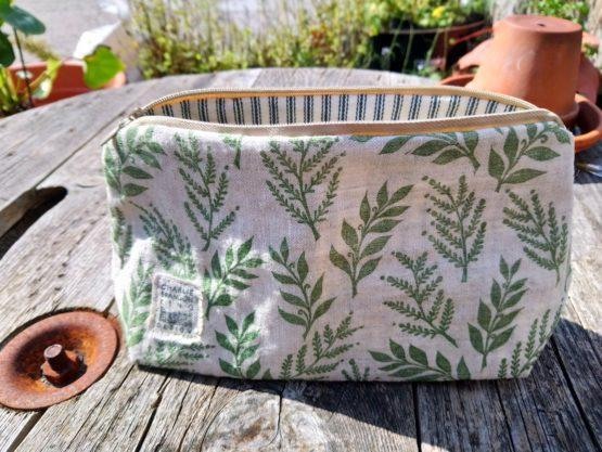green leaf print make up bag inside shot