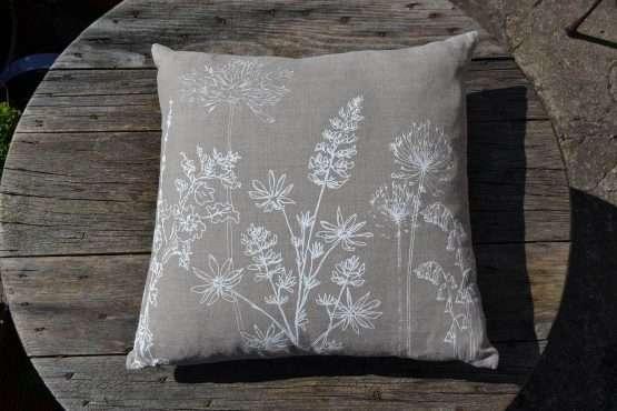 Helen round natural linen garden print cushion