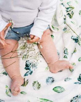 baby legs on forest floor muslin