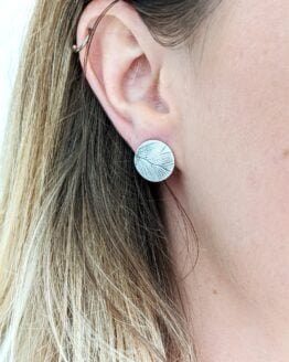 eco silver fern studs on ear
