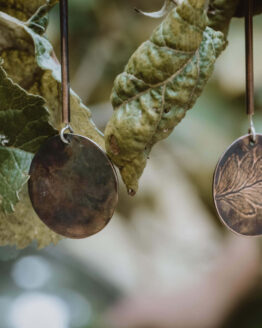 fern leaf tube earrings close up