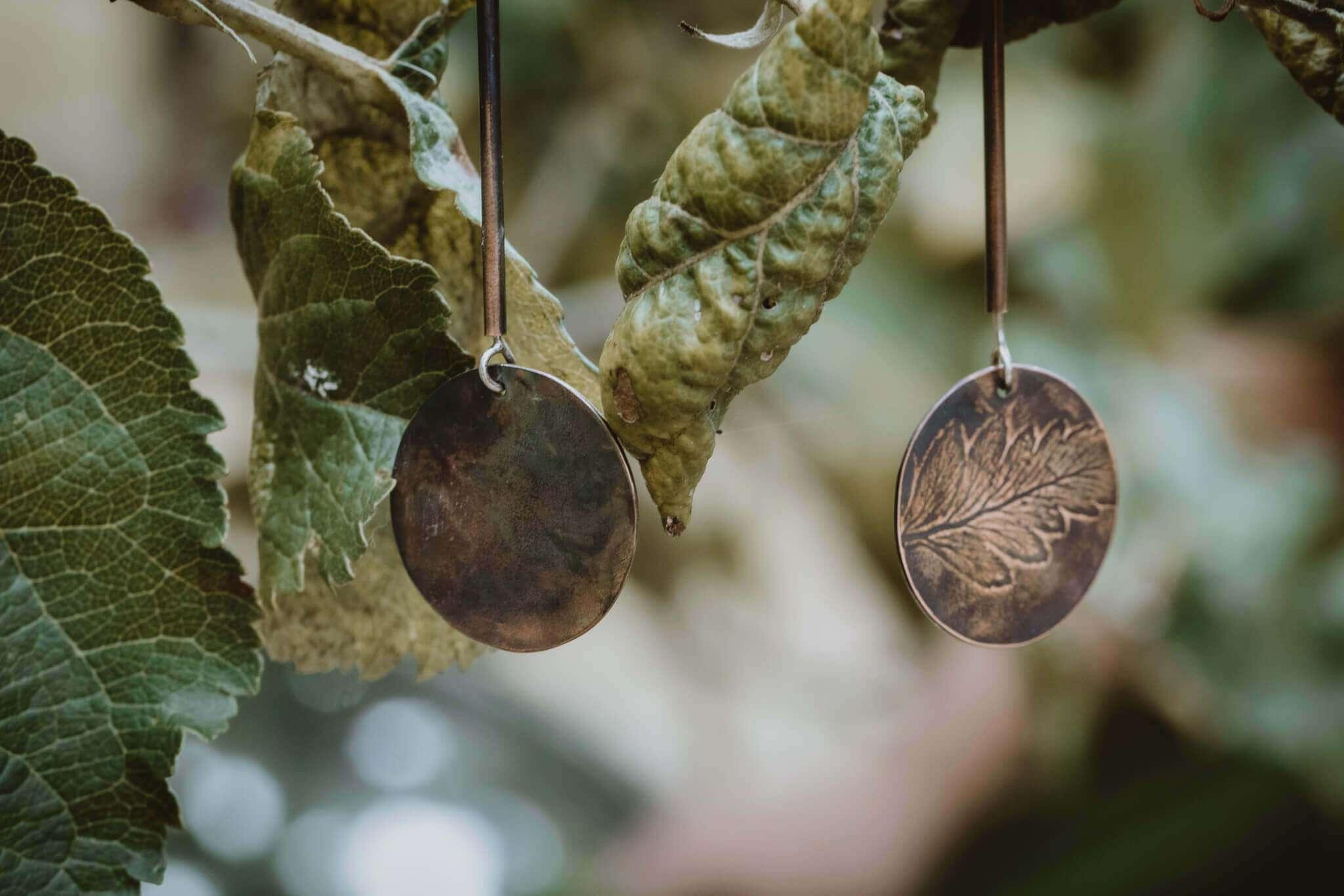 fern leaf tube earrings close up
