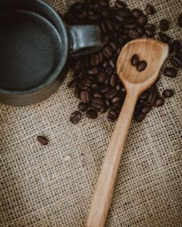 long wooden coffee scoop