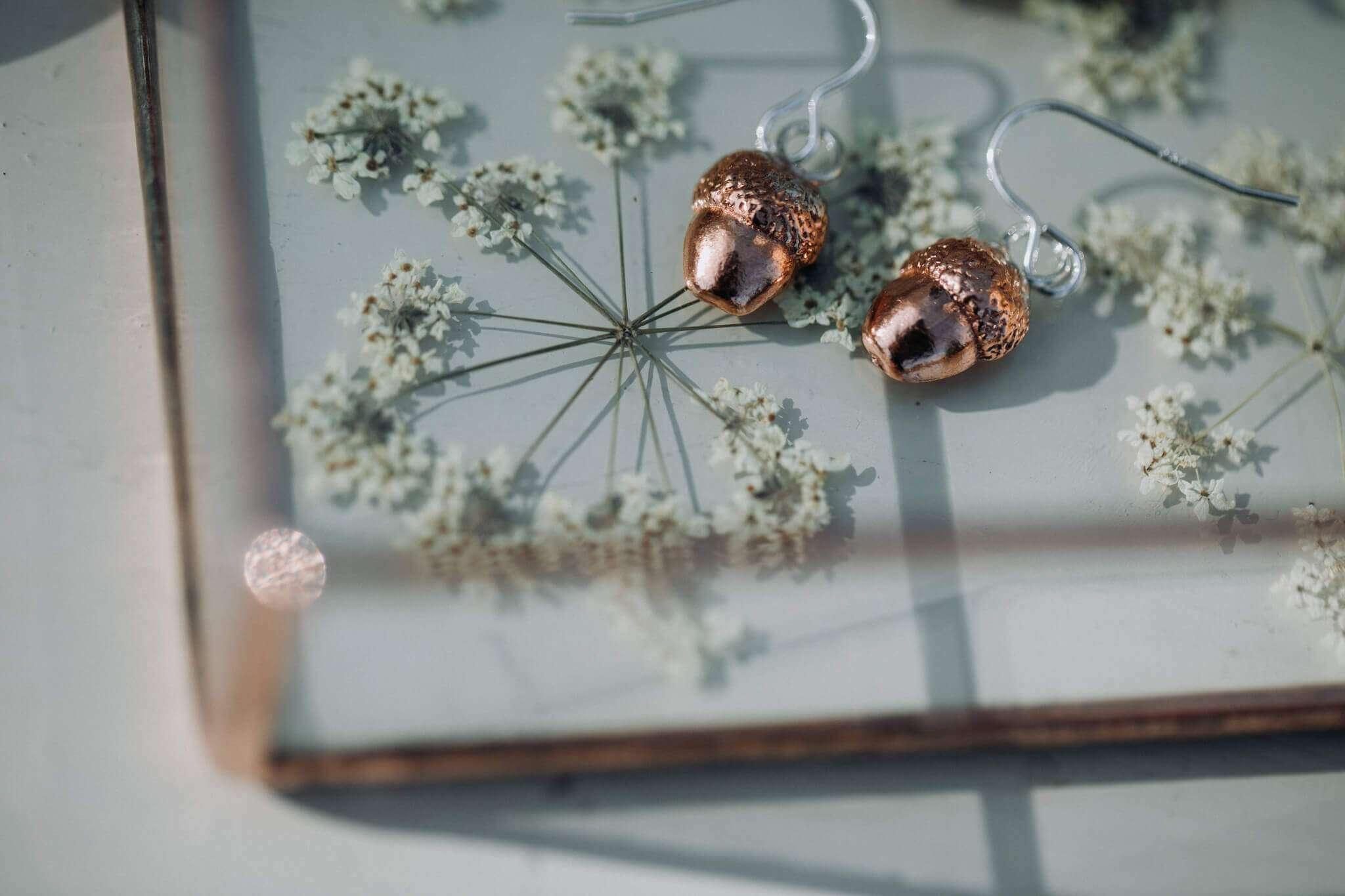 new half acorn copper earrings in tray