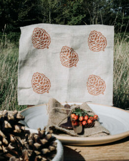 pinecone print tea towel table shot