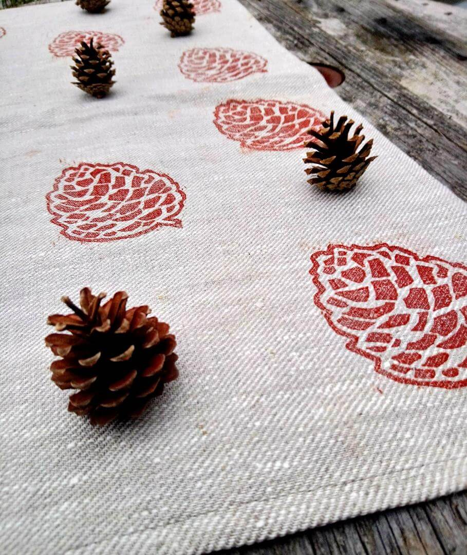 pinecone tea towel open styled shot