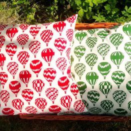 red and green balloon cushions