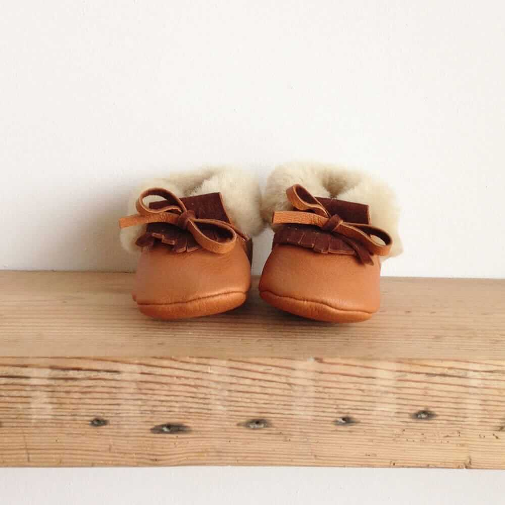 Rose Choules Tan leather baby moccasins front