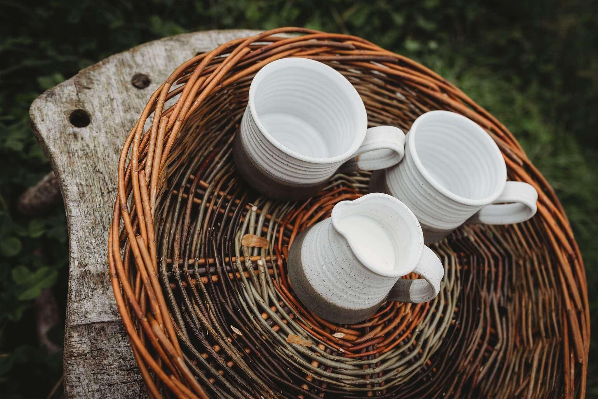 green white stoneware mugs top down